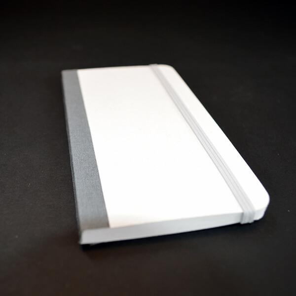 Fälzeln: Fälzelband bei Notizblock weiß