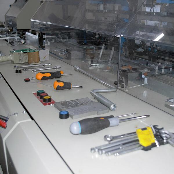Kuvertierung: Kuvertiermaschine und Werkzeuge